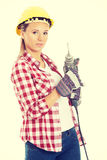 Woman holding drill and wearing safety helmet. Royalty Free Stock Image