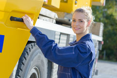 Woman holding driver`s door plant vehicle Royalty Free Stock Image
