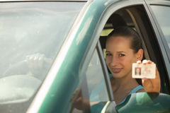 Woman holding driving licence Royalty Free Stock Photography