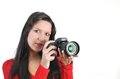 Woman holding DSLR camera in hand Royalty Free Stock Images