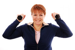 Woman holding dumb bells Royalty Free Stock Images