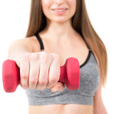 A woman holding a dumbbell Stock Image