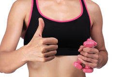 Woman holding dumbbells doing the okay sign Royalty Free Stock Photo