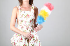 Woman holding a duster Royalty Free Stock Photo