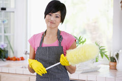 Woman Holding Duster And Wearing Rubber Gloves Stock Photography