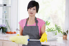Woman Holding Duster And Wearing Rubber Gloves Royalty Free Stock Photo