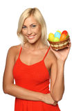 Woman holding Easter eggs Stock Photos