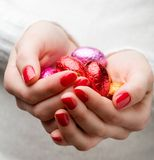 Woman holding easter eggs Stock Photo