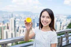 Woman holding egg tart Royalty Free Stock Image