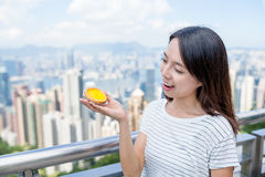 Woman holding egg tart Royalty Free Stock Images