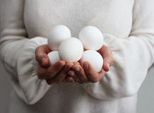 Woman holding eggs Royalty Free Stock Photo