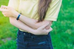 Woman holding elbow. Arm ache royalty free stock photos