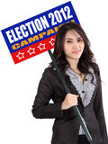Woman holding election sign. Business woman holding election sign campaign to calling people election 2012 Stock Images