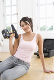 Woman holding electric drill, smiling, portrait Stock Image