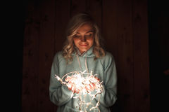 Woman holding electric garland Stock Photography