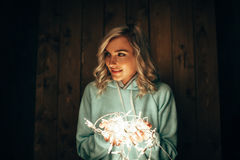 Woman holding electric garland Stock Photo