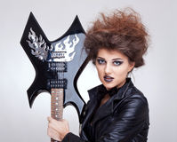 Woman holding an electric guitar Stock Photography