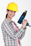 Woman holding electric heater Stock Photography