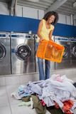 Woman Holding Empty Basket With Clothes On Floor Stock Images