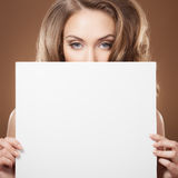 Woman Holding Empty Billboard In Hands Royalty Free Stock Photo