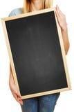 Woman holding empty black chalkboard Stock Photo