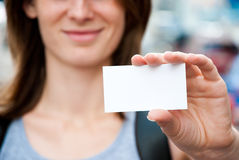 Woman holding empty card Stock Photos