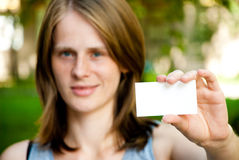 Woman holding empty card Royalty Free Stock Image