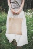 Woman holding empty linen bag. Template mock up Stock Photos