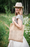 Woman holding empty linen bag. Template mock up. Woman holding empty linen bag outdoor. Template mock up Stock Photos