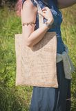 Woman holding empty linen bag. Template mock up stock photography