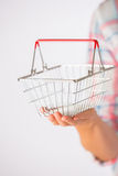 Woman Holding Empty Model Shopping Basket Stock Photography