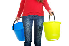Woman holding empty plastic buckets. Royalty Free Stock Images
