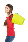 Woman holding empty plastic buckets. Royalty Free Stock Photos
