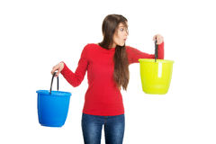 Woman holding empty plastic buckets. Stock Photos