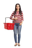Woman holding an empty shopping basket Stock Photo