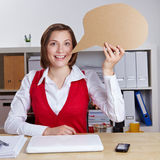 Woman holding empty speech balloon Stock Photos
