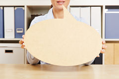 Woman holding empty speech bubble in front of mouth Stock Photography
