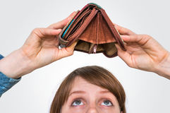 Woman holding an empty wallet, she hasn`t money stock photos