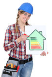 Woman holding energy rating card Stock Photo