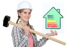 Woman holding energy rating information Royalty Free Stock Photo