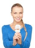 Woman holding energy saving bulb Stock Image