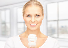 Woman holding energy saving bulb Royalty Free Stock Photo