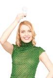 Woman holding energy saving bulb Stock Photography