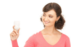 Woman holding energy saving bulb Royalty Free Stock Photo