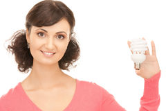 Woman holding energy saving bulb Royalty Free Stock Photography