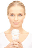 Woman holding energy saving bulb Stock Photography