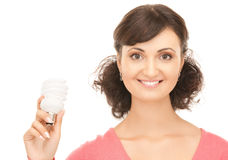 Woman holding energy saving bulb Stock Images