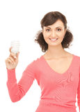 Woman holding energy saving bulb Royalty Free Stock Images