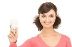 Woman holding energy saving bulb Stock Photo