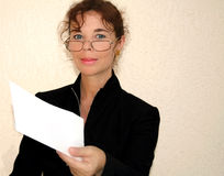 Woman holding envelope. Portrait of a middle age woman holding a white envelope or folded document Royalty Free Stock Photos